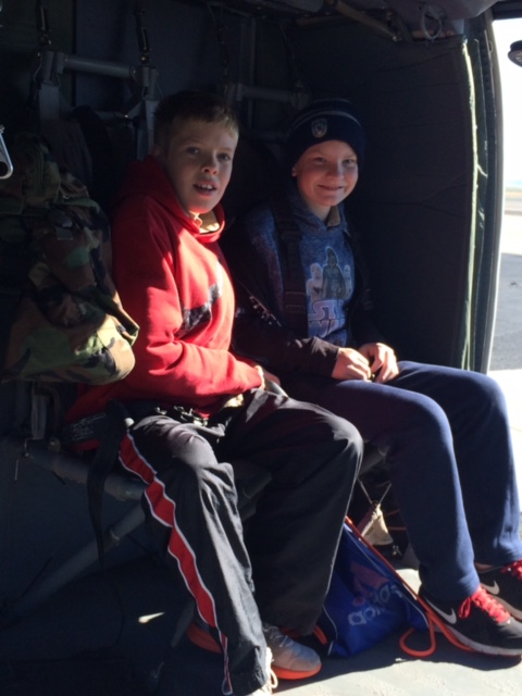 Scouts enjoy sitting in a helicopter at the Youth Aviation Adventure